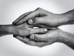 Couple two hands together tantra intimacy